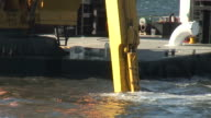 (HD1080i) Dredging Sediment Mud From Under Water (Close Up) video
