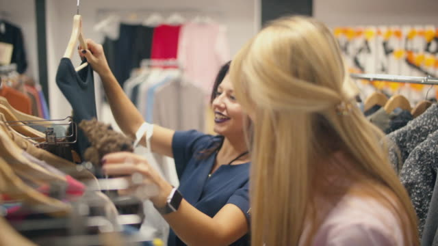 Dresses, skirts, blouses in store. Women's clothing in the store video