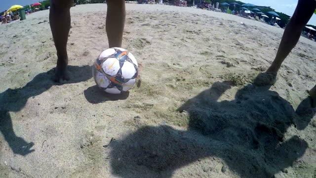 Dribbling playing beach football SLOW MOTION video