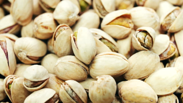 Dried roasted salted appetizing pistachios rotating video