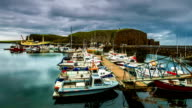Drifting boats at the dock on a cloudy day. Stykkishólmur Harbour, Iceland video