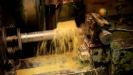 Drilling a metal blank on automatic old and dirty machine with coolant video