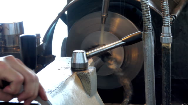 Drilling steel, slowmotion. Drilling Machine processes the metal, cut out the shape.  Chinese factory or underground factory video