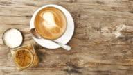 drink coffee latte in garden view video
