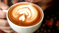 drinking a cup of latte art coffee video