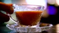 Drinking hot milk tea in cafe video