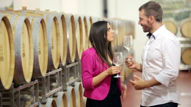 Drinking white wine in the wine cellar video