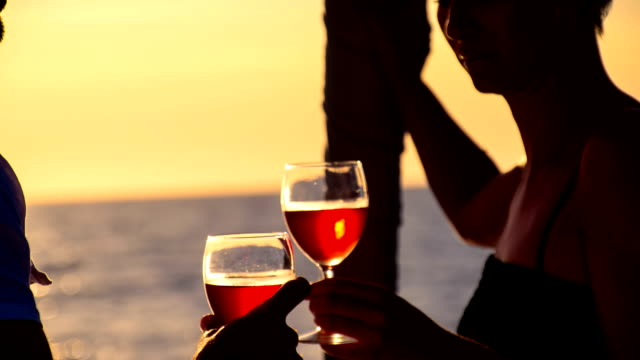 CU Drinking Wine On A Sailboat At Dusk video