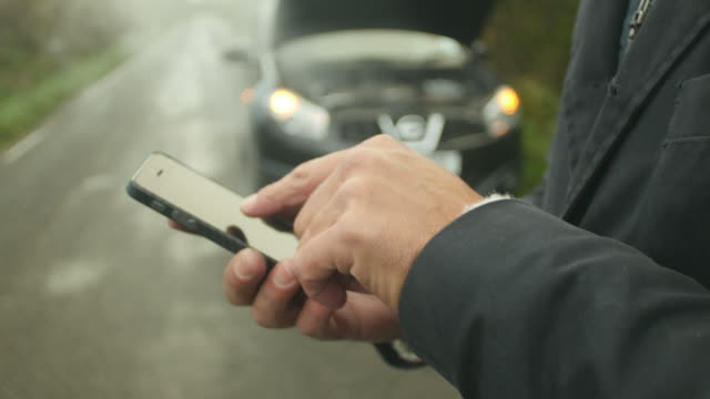 Driver Broken Down Calling Recovery Service On Mobile Phone video