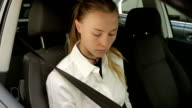 A driver checking the condition of a seatbelt video