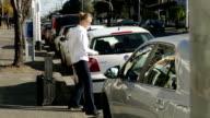 A driver closes a car boot video