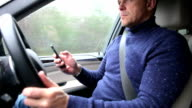 Driver Using Mobile Phone Whilst Driving Car video