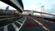 Driver's rear view variation over the Rainbow Bridge. video