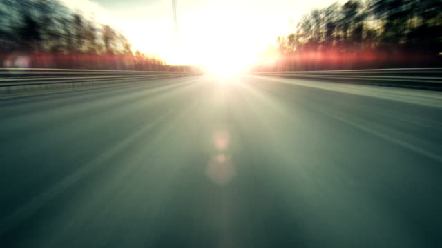 Driving a car at sunset video