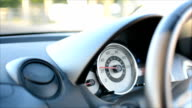 Driving a car, focus on speedometer video