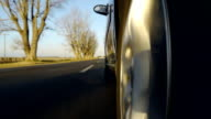 Driving a car on country road. Slow Motion - side video
