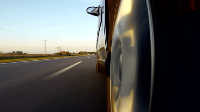 Driving a car on country road. Time-Lapse POV side video