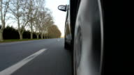 Driving a car on country road. Wheel spinning POV video
