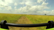 Driving along the dirt road in African safari video