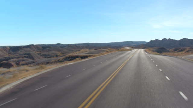 FPV: Driving along the empty road snaking through the Badlands mountain desert video