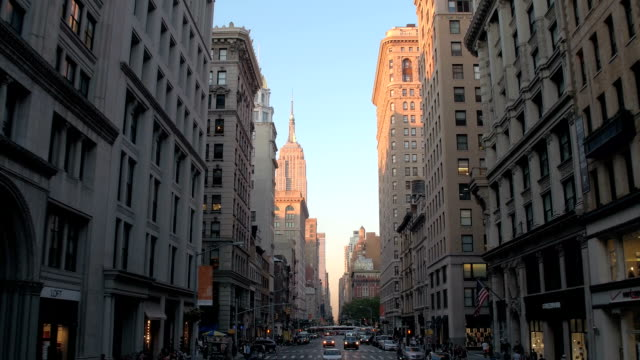 Driving along the streets of New York City distancing from Empire State Building video