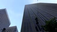 Driving around modern glassy sky high skyscrapers in big city video