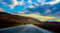 Driving at sunset on desert road video