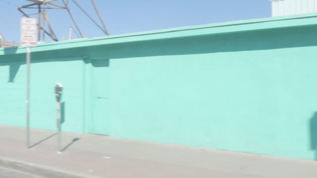 Driving by a Light Blue Wall in a Border Town video