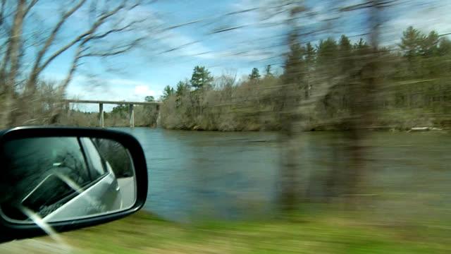Driving car down rural road video