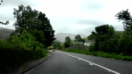 Driving car in English countryside video