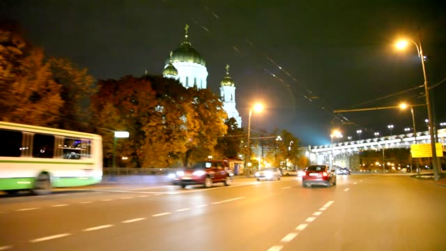 driving car in night moscow past Cathedral of the Redeemer video