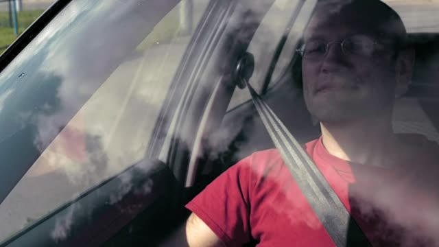 Driving city streets POV outside windshield view video