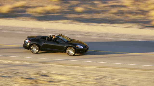 Driving convertible along California coast, zoom out video