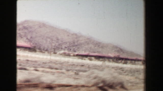 1968: Driving in southwestern USA dry desert landscape passing classic 1940s car. video