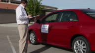 Driving instructor takes notes video