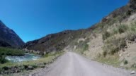 Driving off road in New Zealand along river bank video