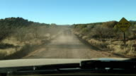 Driving on a dirt road front view POV from windshield video