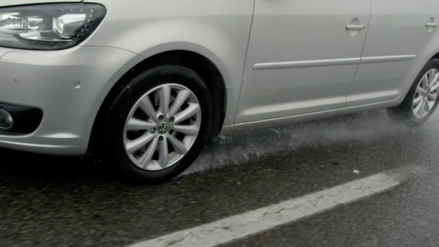 SLOW MOTION CLOSE UP: Driving on a highway in heavy rain video