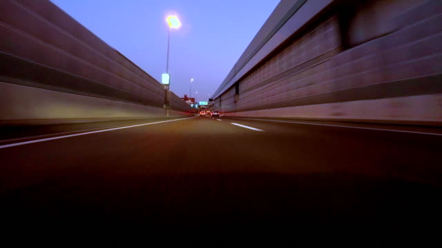 Driving on highway at dusk - 4K- video