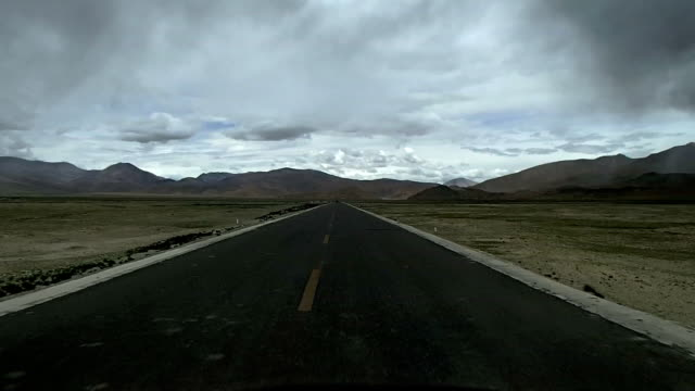 driving on highway through tibetan plateau video