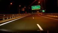 Driving on Highway/interstate at night,  Exit sign of the City Of Detroit, Michigan video