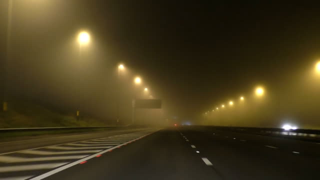 Driving on misty motorway at night video