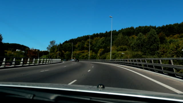 Driving on motorway bridge on a bright day video