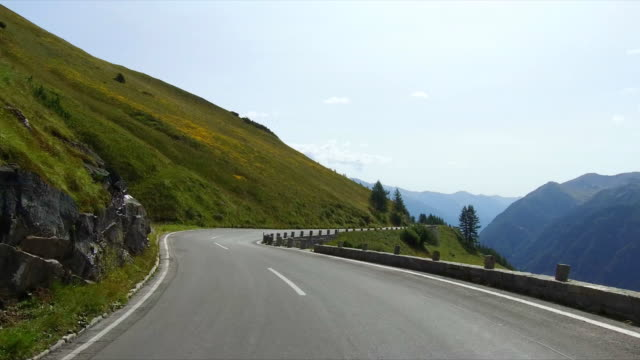 Driving on road to Grossglockner at the european alps in Austria video