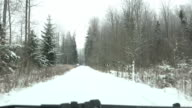 Driving on snow covered way in winter forest. video