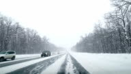 Driving POV on snowy country road. Winter Snow Mountain Road Driving. Forest. Driving video