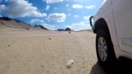Driving on the beach with a four wheel drive in Africa video