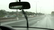 Driving on the freeway while rains. POV - video