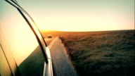 Driving Over Hill With Setting Sun video