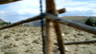 driving past an old fence on the mountain video